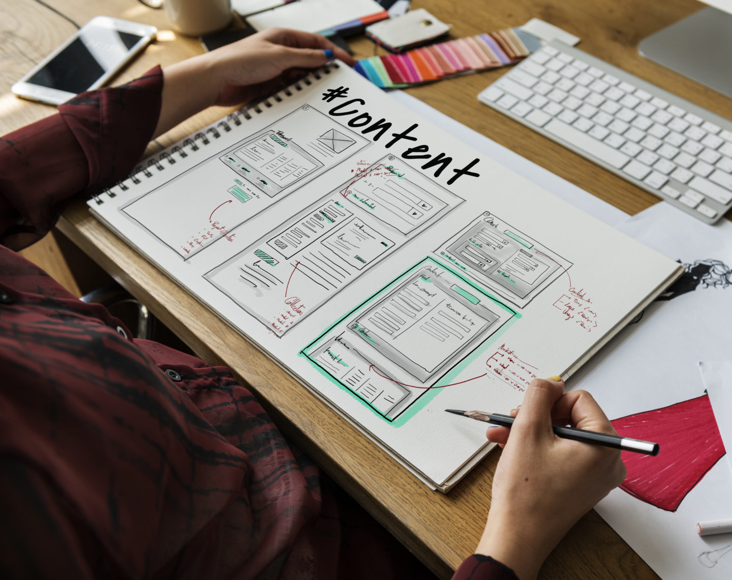 person working on content and design at desk