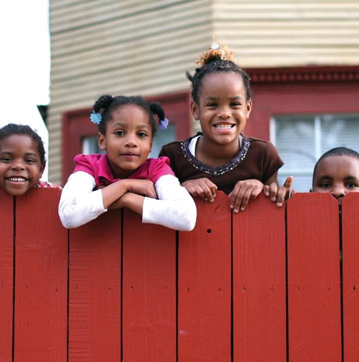 nonprofit housing kids looking over fence