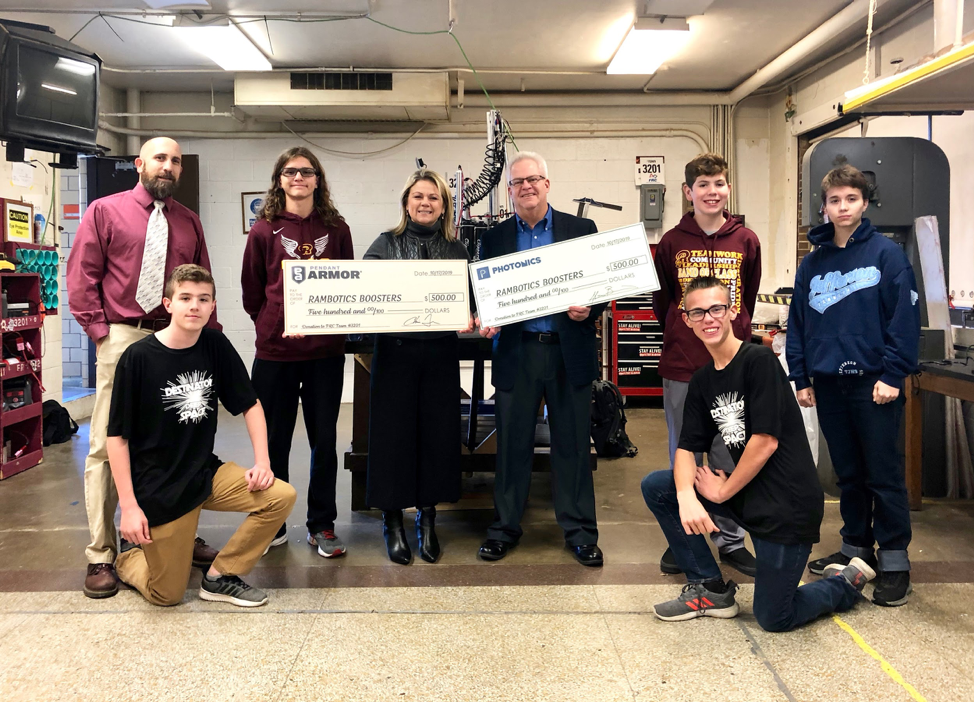 Ross Rambotics donation presentation from Photonics Inc and Roboworld's Pendant Armor